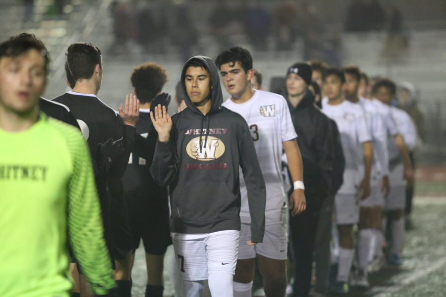 Players shake hands after the varsity team lost to Bella Vista 3-1.