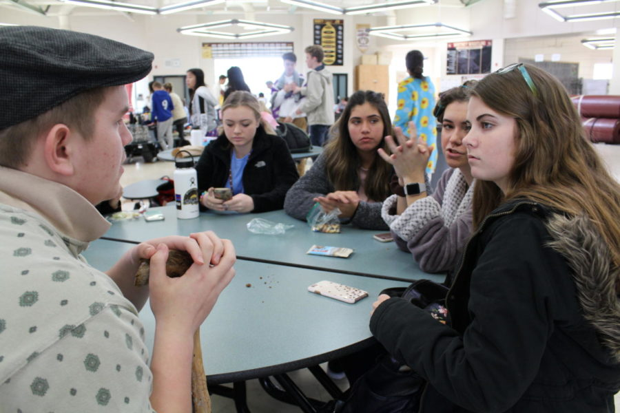 After the class announcements for the day, Wyatt Arbaugh and Natalie Hamm discuss final details for the dance during Mr. Travis Mougeotte's sixth period leadership class. Photo by Renese Lopez