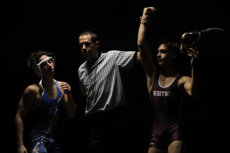 Cole Kachmar defeats his opponent at the match against Rocklin Nov. 28.