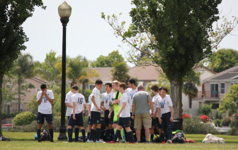 Varsity soccer players compete in club game