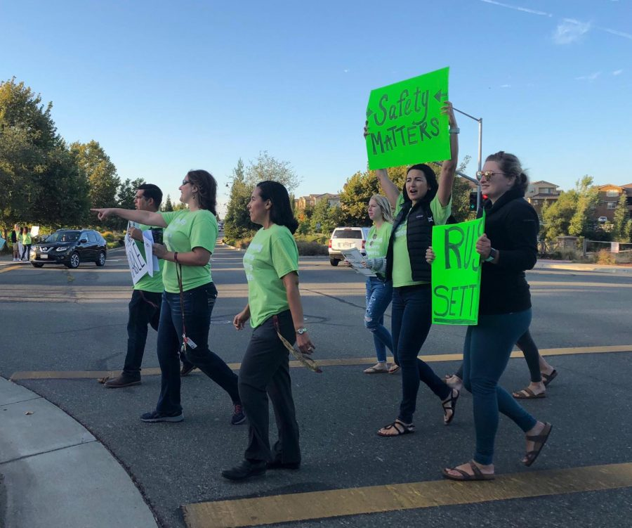 Before school, union members gather outside of campus to raise awareness of their unsettled negotiations. Photo by Emily Cowles