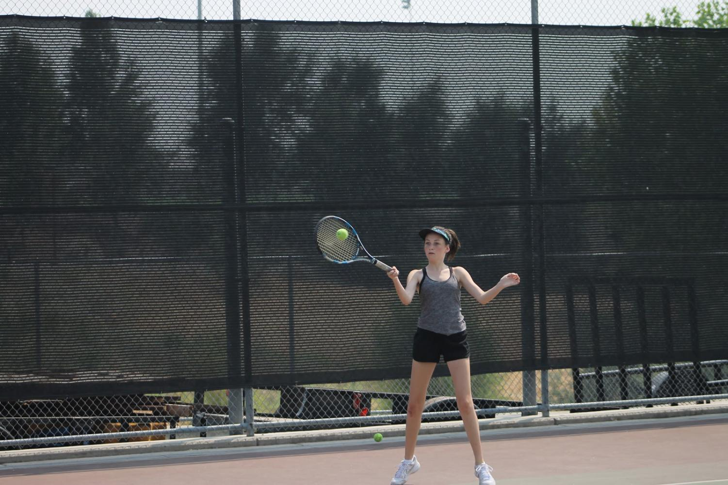 While at practice Aug. 9, Gabby Mehren receives and returns a serve during warm-ups. Photo by Brenden Jacoby