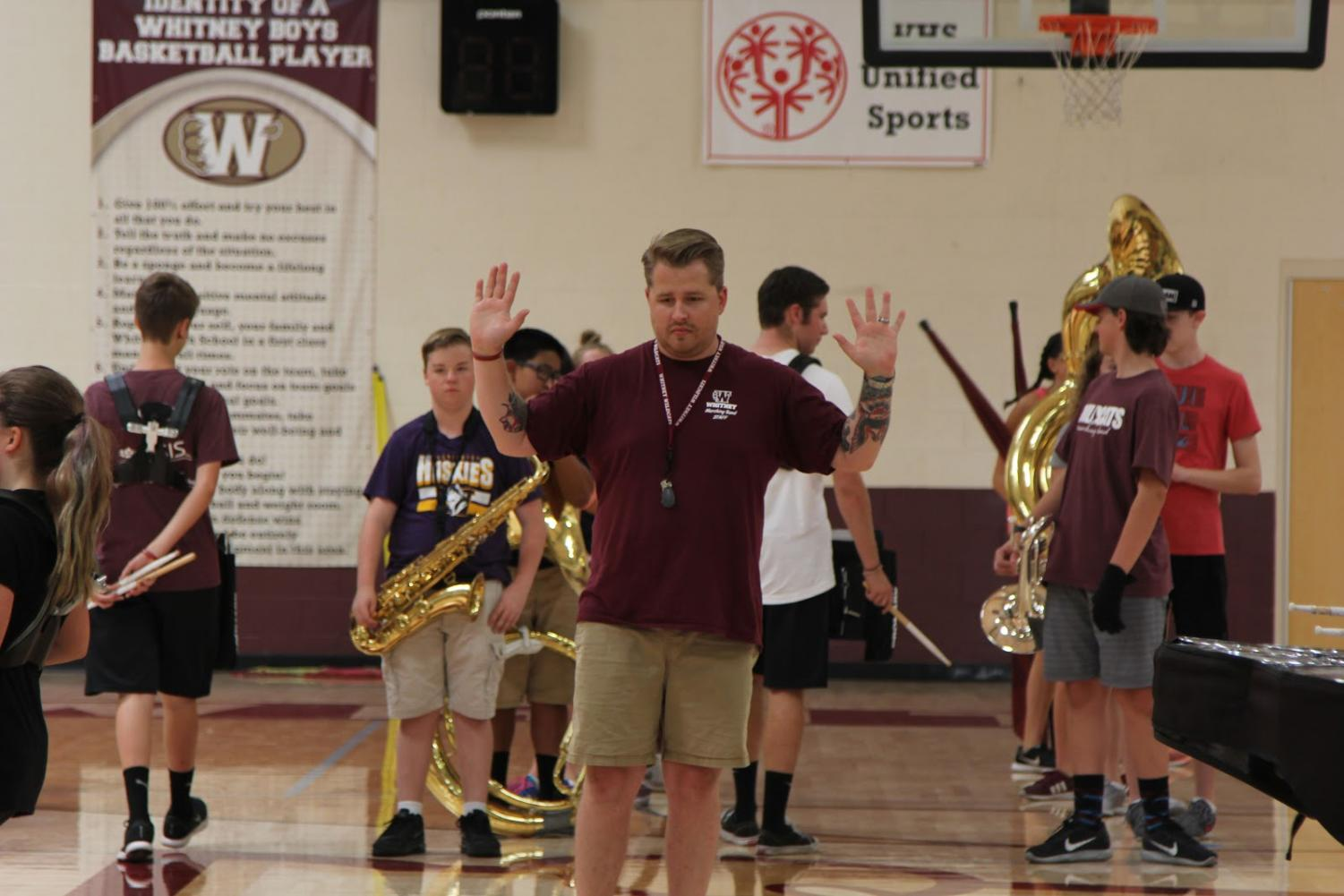 During band camp, Aug. 8, Mr. Kasey Searles instructs his students on where and when to stop marching, in preparation for their competitions. Photo by Emma Accacian