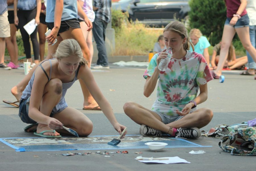 While tearing down and painting over the previous senior parking spot, Olivia Simmons invites her younger sister Isabel to help make the parking spot her own.
