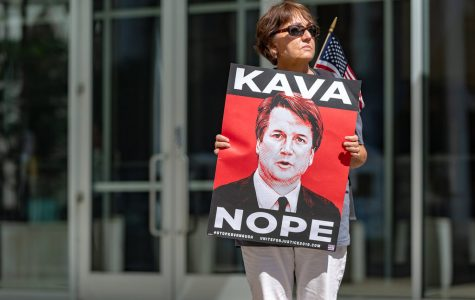 Protester against supreme court justice nominee, Brett kavanaugh, outside the Warren E. Burger Federal Building in St. Paul, Minnesota. Photo from Flickr, with permission.