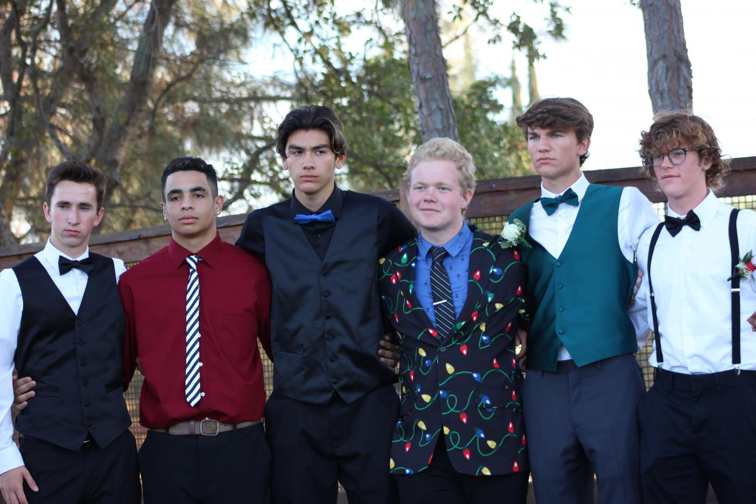 Before Rocklin's Homecoming dance Sept. 29 Whitney students Ryan King, Bryce Simpson, Daniel Parker, David Brosnan and Bennett Woodward pose with Rocklin student Quincy Dungan. Photo by Adriana Williams.