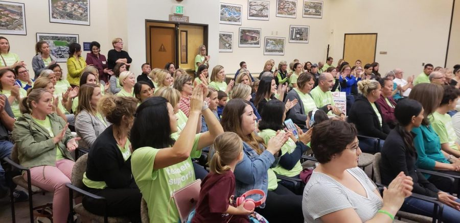 Teachers clap and cheer after hearing a fellow educator share her story working for the district. Photo by Alaina Roberts.