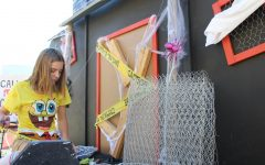 During last-minute Homecoming float building session, students finish haunted floats