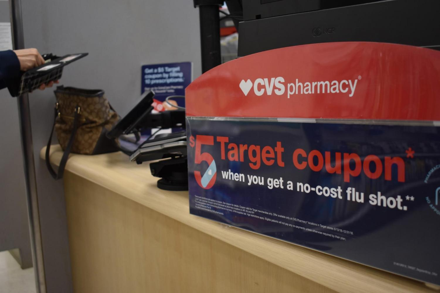 In time for flu season, Target's CVS pharmacy promotes a deal to receive a $5 coupon alongside a vaccination. Places like Target allow individuals to have options apart from their doctors' offices to get the shots. Photo by Grace Chang.