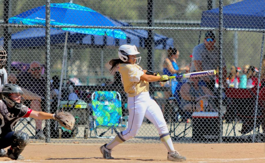 During the softball game on Oct. 28 against All American Mizuno, Alexis Caretti bats for Foothill Gold. Photo by Joel Abueg