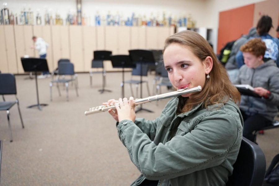 Rehearsing repertoire for the Capitol Section Honor Band on Jan. 12, Carina Geist practices in the band room at intervention.