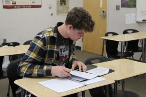 After school Jadon Buller is in Mrs. Seabrooks Dual Enrollment room working on a response for a 2nd semester assignment. The purpose of it is to carefully analyze the articles given and relating the context with what they are learning about U.S history.