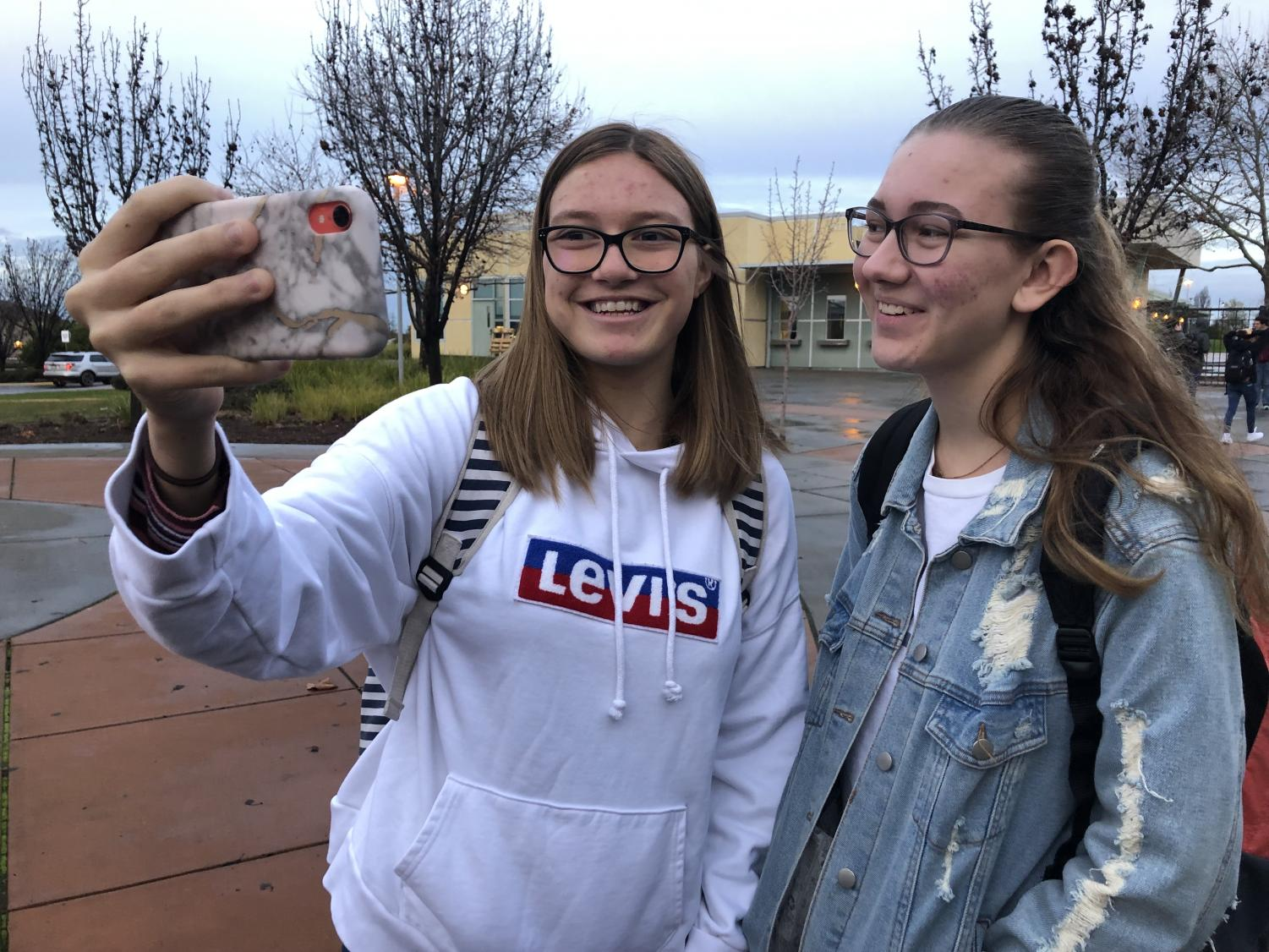 Before school on Jan 9., Joy Jeung and Summer Hensley film a vlog about their daily school life. Photo by Alicia Cho