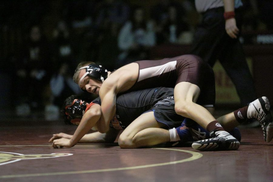 During the men´s varsity wrestling match against Folsom Jan. 16, Isaiah Schannep pins his opponent. Wildcats lost 59-18. Photo by Brenden Jacoby.