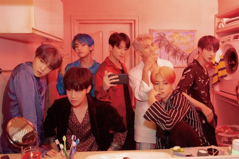 "For the ""Map of the Soul: Persona"" concept photos, BTS poses in front of a bathroom mirror. Photo from Big Hit Entertainment, used with permission under fair use."