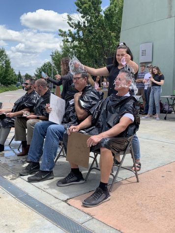 "At the ""Twin Day"" LTA May 23, Kylee Jo pops water balloons over Mr. Paul Hanks and Mr. Mike Gimenez's heads after they incorrectly answered a question about the school year's history. Photo by Adriana Williams."