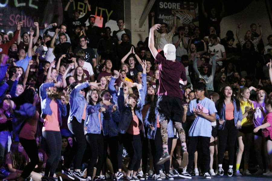 Kade Church hypes up the Junior Class as he enters the end of the year rally.