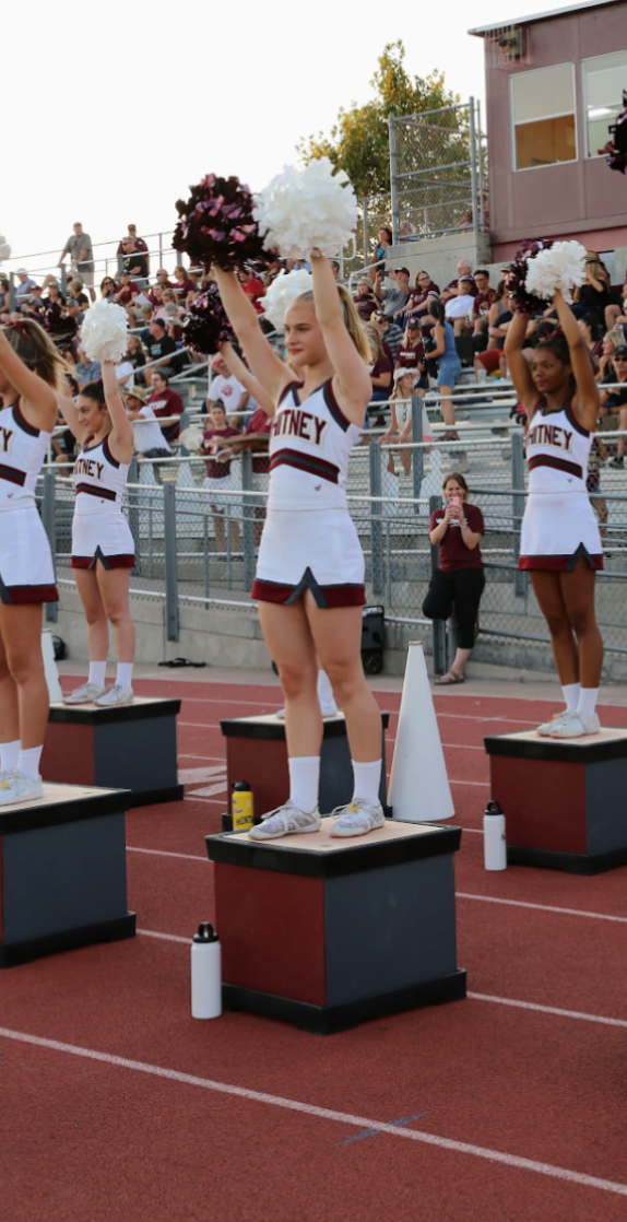 Kara Brent preforms sideline cheers during the very first varsity football game of the season.