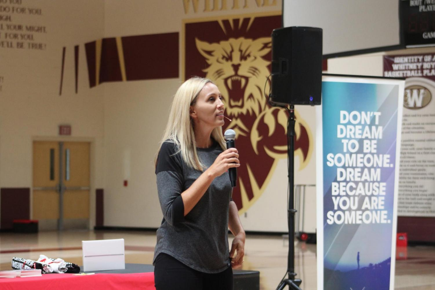 """During the Air 1's """"Dare to Dream"""" assembly, Erin Weidemann talks to sophomores about the importance of chasing their dreams through her own experiences as a softball player and being a five-time cancer survivor. Photo by Sofia McMaster."""