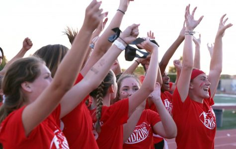Before the freshman versus sophomore game, sophomore powder puff players cheer on the sidelines. The underclassmen played Sept. 23 at 6 p.m. Photo by Dylan de Valk.