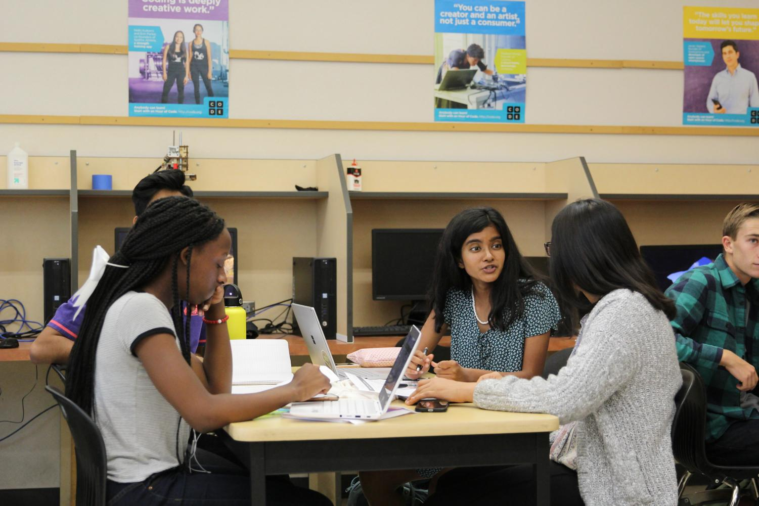 In Mr. Matt Strinden's eighth period AP Computer Science Principles class, Ifetayo-Michaela Spencer, Shawn Singh, Ashvika Nair and Ryela Gill discuss the ways to solve IP and Internet related problems as part of the assignment. Photo by Sofiia Malushkina.
