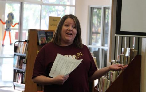 During a meeting in the library Oct. 31 at break, Mrs. Jana Kingery introduces herself to marching band members as interim director. Members were called into the library during second period in order to understand what the rest of their season was going to consist of. Photo by Dylan de Valk.