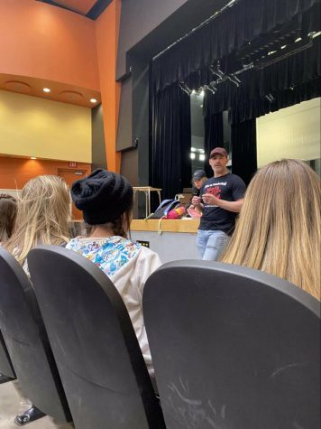 During rehearsal, theatre director Mr. Joshua Ansley gathers with cast members to discuss how the show is going and reminds them to make sure the crew is prepared for it by practicing every day. Opening night is March 5. Photo by Olivia Cull.
