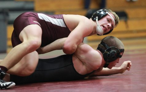 Wrestling captain, Isaiah Schannep attempts to take down his opponent.