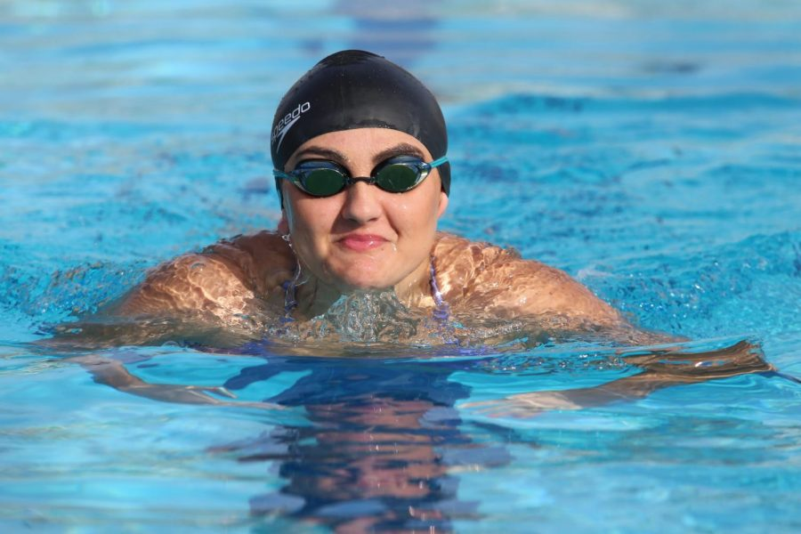 Isabella Dunkhase focuses on breaststroke during one of the last practices of the season. Photo by Dylan DeValk.