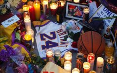 Outside of the Staples Center, fans leave memorabilia and candles as a tribute at Kobe Bryant's memorial service