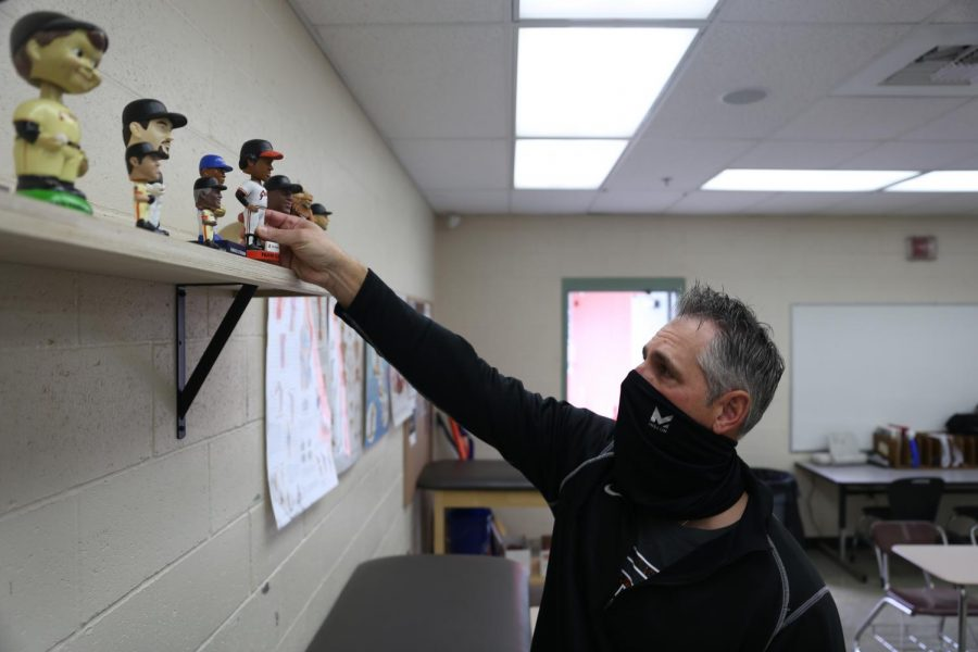 As a way to promote diversity, Mr. Michael Gimenez adds to his bobblehead collection in the sports medicine room.