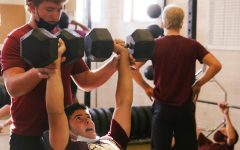 In preparation for the Quarry Bowl, varsity football players Cole McCracken and Ben Counter complete their last set of weight training. Photo by Benjamin Lynn.