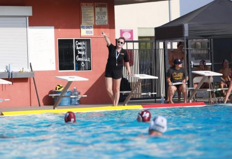 At the opening home game against Ponderosa, newly appointed mens varsity water polo coach Hannah Widman points to where players should reposition after an ejection. Photo by Aaryan Midha.