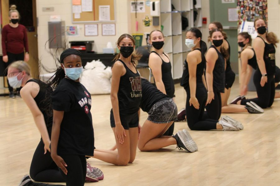On Sept. 16 after school, the dance team practices for their Quarry Bowl performance, which will include a combined kickline with Rocklin High's dance team. Photo by Sara Kaulahao