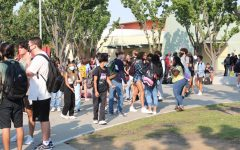 Students converse with each other during the new PAWS period, which was previously called Intervention. PAWS is everyday from 9:06-9:31 a.m. Photo by Francheska Pontillas.