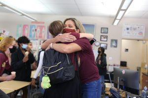 During an ice cream party celebration, Olivia Roberts embraces Mrs. Penny Shelton. Shelton threw the party as a way to say goodbye to her students and celebrate her transition from teaching to the assistant principal role. She will be starting her new position Sept. 27. Photo by Sofia McMaster.
