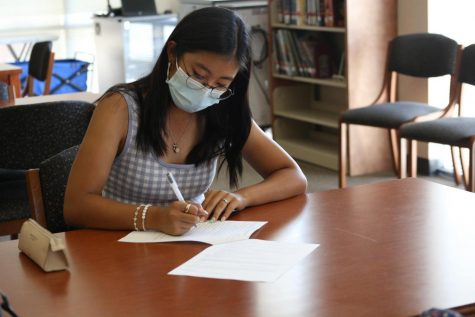 Kiana Kim completes a club application in the library to establish The Human Rights Advocacy Club. Club applications ended Sept. 1.  Photo by Nikhita Tandon.